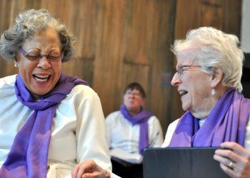Gloria Brown (left) and Sheila Fleming (right) share a laugh during the Good Memories Choir's debut concert (Chris Walljasper)