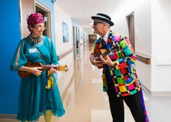 Miss Beatrice (Ilene Weiss) and Dapper Dan (Dikki Ellis) sing, play instruments, crack jokes, and tell stories to people in geriatric residential care and elders in critical care through Vaudeville Visits at Saint Barnabas Medical Center. (credit: Florence Montmare)