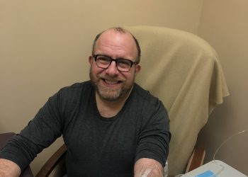 Phil Gutis gets an infusion as part of a drug trial that eventually failed.