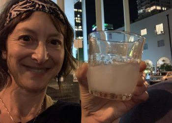 Author Jenn Knudsen enjoying a drink at a bar in Tel Aviv during a recent trip to Israel